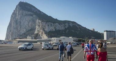 People coming from Spain cross the airport of Gibraltar to take part at the National Day celebrations at the British territory of Gibraltar.
