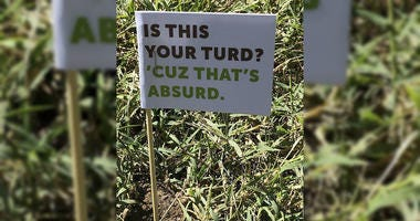 Officials in a southwest Missouri city are planting small flags in piles of abandoned dog poop as part of a campaign to get residents to clean up after their pets downtown.