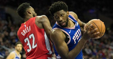 Philadelphia 76ers center Joel Embiid (21) drives past Washington Wizards forward Jeff Green (32) during the third quarter at Wells Fargo Center.