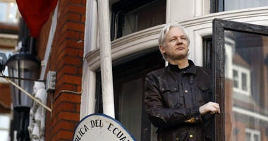 In this May 19, 2017 file photo, WikiLeaks founder Julian Assange gestures to supporters outside the Ecuadorian embassy in London, where he has been in self imposed exile since 2012.