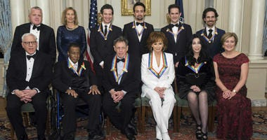 Front row from left: David Rubenstein, Wayne Shorter, Philip Glass, Reba McEntire, Cher, Deborah Rutter; back row from left: Deputy Secretary of State John Sullivan, Grace Rodriguez, Thomas Kail, Lin-Manuel Miranda, Andy Blankenbuehler, and Alex Lacamoire