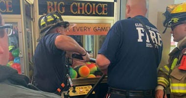Emergency crews rescue a child from a game at the Gloucester Premium Outlets in Blackwood, N.J.