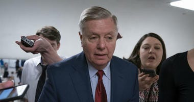 In this March 13, 2019, photo, reporters pose questions to Sen. Lindsey Graham, R-S.C., at the Capitol in Washington, Wednesday, March 13, 2019.