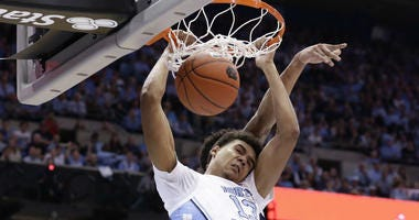In this Dec. 15, 2018, file photo, North Carolina's Cameron Johnson (13) dunks against Gonzaga during the first half of an NCAA college basketball game, in Chapel Hill, N.C.