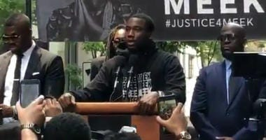Meek Mill takes the stage at a Justice4Meek rally to thank supporters.
