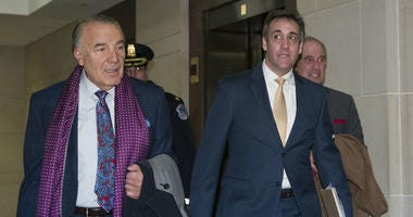 Michael Cohen, right, President Donald Trump's former personal lawyer, arrives to testify before a closed-door hearing of the House Intelligence Committee accompanied by his lawyer, Michael Monico of Chicago, on Capitol Hill, Thursday, Feb. 28, 2019.