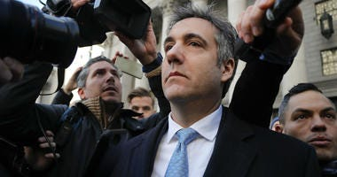 In this Nov. 29, 2018, file photo, Michael Cohen walks out of federal court in New York.