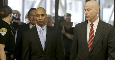 Former Minneapolis police officer Mohamed Noor walks through the skyway with his attorney Thomas Plunkett, right, on the way to court for the verdict Tuesday, April 30, 2019, in Minneapolis, Minn.