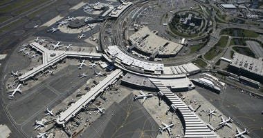 In this Sept. 8, 2008 file photo, planes are parked at terminals at Newark Liberty International Airport in Newark, N.J.