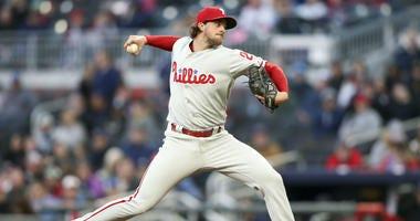 Apr 16, 2018; Atlanta, GA, USA; Philadelphia Phillies starting pitcher Aaron Nola (27) throws a pitch against the Atlanta Braves.
