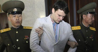 In this March 16, 2016, file photo, American student Otto Warmbier, center, is escorted at the Supreme Court in Pyongyang, North Korea.