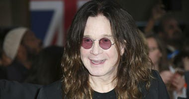 In this Sept. 28, 2015 file photo, Ozzy Osbourne poses for photographers upon arrival at the Pride of Britain Awards 2015 in London.
