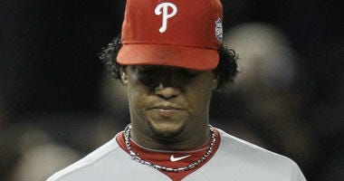 In this Nov. 4, 2009, file photo, Philadelphia Phillies' Pedro Martinez looks at his ball after giving up a two-run home run to New York Yankees' Hideki Matsui during the second inning of Game 6 of the Major League Baseball World Series in New York.