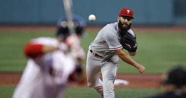 Philadelphia Phillies starting pitcher Jake Arrieta delivers during the first inning of a baseball game against the Boston Red Sox at Fenway Park in Boston, Tuesday, July 31, 2018.