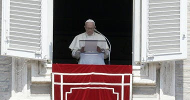 In this Sunday, Aug. 19, 2018 file photo, Pope Francis prays for the victims of the Kerala floods during the Angelus noon prayer in St.Peter's Square, at the Vatican.
