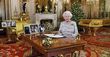 In this image released on Tuesday, Dec. 25, 2018, Britain's Queen Elizabeth poses for a photograph after she recorded her annual Christmas Day message, in the White Drawing Room of Buckingham Palace, London.