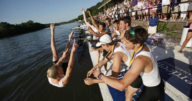 Cowswain Stephen Veland is thrown into the Schuykill after Gonzaga won the Boys Senior Eight Final in the Stotesbury Cup in 2012.