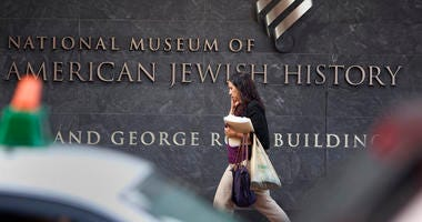 A passerby walks in front of the American Jewish History Museum.
