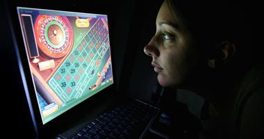 A woman using an internet gambling website to play online roulette.