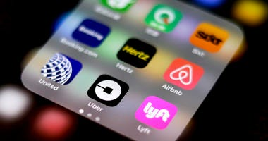 Uber and Lyft apps on an iPhone