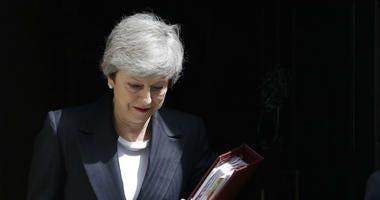 Britain's Prime Minister Theresa May leaves 10 Downing Street to attend the weekly session of Prime Ministers Questions in Parliament in London, Wednesday, May 22, 2019.