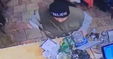 Surveillance video shows a man stealing a tip jar from the counter of the Judah Mediterranean Grille on Krewstown Road.