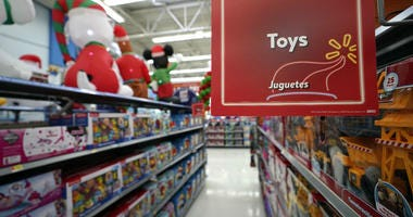 In this Friday, Nov. 9, 2018 photo, toys sit on the shelves at a Walmart Supercenter in Houston.