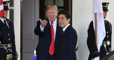 President Donald Trump welcomes Japanese Prime Minister Shinzo Abe to the White House in Washington, Thursday, June 7, 2018.