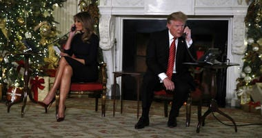 President Donald Trump and first lady Melania Trump each speak on the phone sharing updates to track Santa's movements from the North American Aerospace Defense Command (NORAD) Santa Tracker on Christmas Eve, Monday, Dec. 24, 2018.