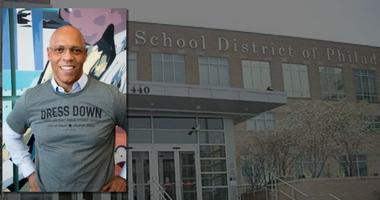 Superintendent William Hite poses in a Dress Down for Philly Public Schools T-shirt.