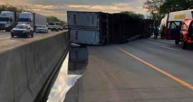 A semi-trailer hauling honey overturned.