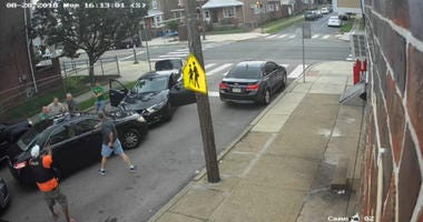 Surveillance video shows six officers, in civilian clothes, surrounding Jeffrey Dennis in Tacony, Aug. 20, 2018.