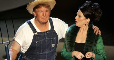 "Donald Trump and actress Megan Mullally perform the ""Green Acres"" theme onstage at the 57th Annual Emmy Awards, Sept. 18, 2005 in Los Angeles, California."