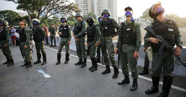 Uprising soldiers stands outside La Carlota air base in Caracas, Venezuela, Tuesday, April 30, 2019.