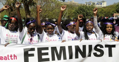 Kenyan women shout slogans during a march to mark International Women's Day in Nairobi, Kenya, Friday March 8, 2019.