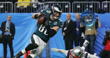 Philadelphia Eagles tight end Zach Ertz (86) scores a touchdown past New England Patriots free safety Devin McCourty (32) during the fourth quarter in Super Bowl LII at U.S. Bank Stadium.