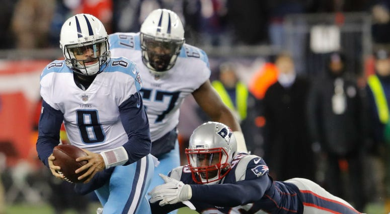 New England Patriots linebacker Geneo Grissom (96) sacks Tennessee Titans quarterback Marcus Mariota (8) in the AFC Divisional playoff game at Gillette Stadium.