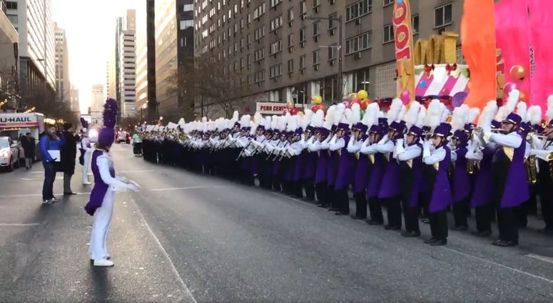 The West Chester University Golden Rams Marching band warms up before the start of the Philadelphia Thanksgiving Day Parade.