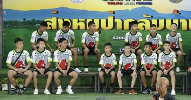 Members of the rescued soccer team and their coach sit during a press conference discussing their ordeal in the cave in Chiang Rai, northern Thailand, Wednesday, July 18, 2018.