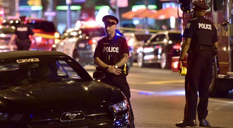 Police work the scene of a shooting in Toronto on Sunday, July 22, 2018.
