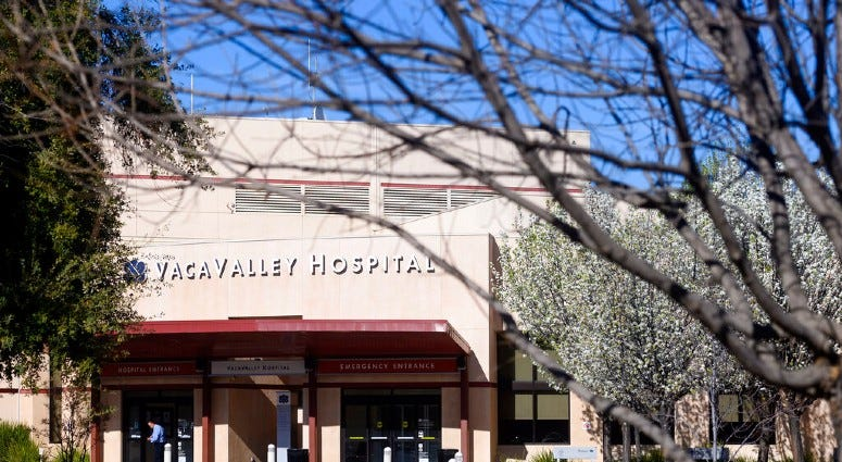 A person enters NorthBay VacaValley Hospital, where a woman diagnosed with coronavirus previously sought treatment, on Thursday, Feb. 27, 2020, in Vacaville, Calif.