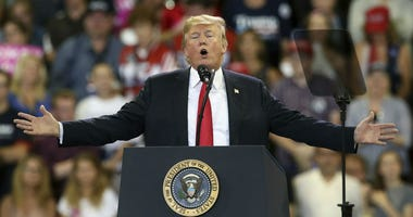 In this June 20, 2018 file photo, U.S. President Donald Trump speaks at a campaign rally in Duluth, Minn.