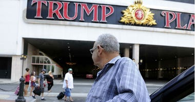 A cab driver waits outside the Trump Plaza on July 30, 2014 in Atlantic City, N.J.
