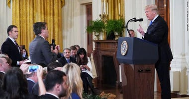 Trump clashes with Acosta in testy exchange