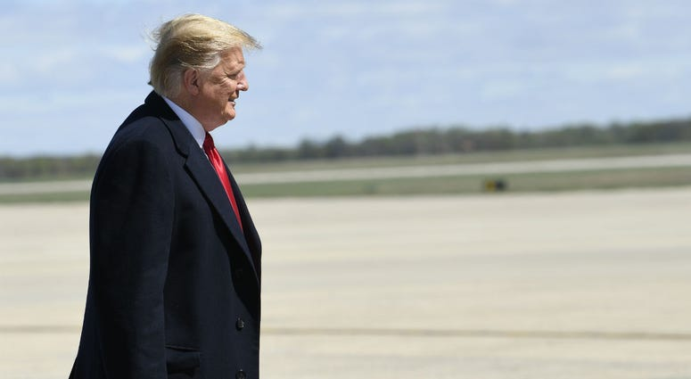 President Donald Trump walks towards the steps of Air Force One at Andrews Air Force Base in Md., Monday, April 15, 2019. Trump is heading to Minnesota for a tax day event.