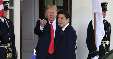 President Donald Trump welcomes Japanese Prime Minister Shinzo Abe to the White House in Washington, Thursday, June 7, 2018.