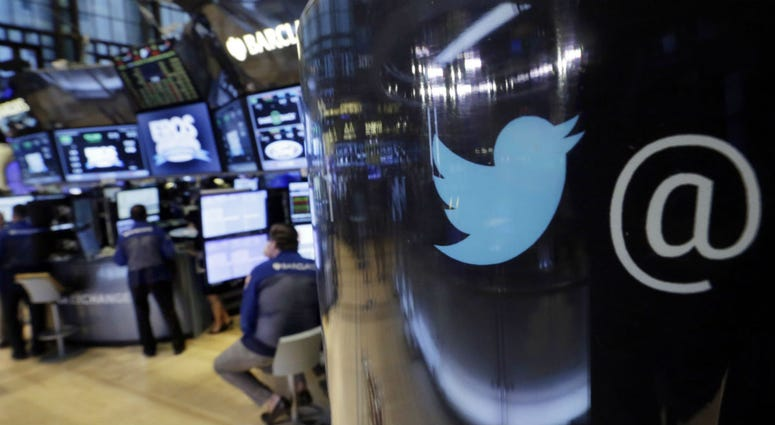 In this Oct. 13, 2015, file photo, the Twitter logo appears on a phone post on the floor of the New York Stock Exchange.