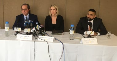 Attorney Gerald Williams left), of the law firm Williams Cedar, is accompanied by associates during a press conference of a civil lawsuit involving a former priest from the Diocese of Allentown.