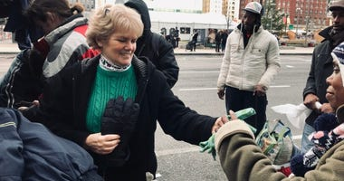 Helen Ober and her family distribute clothing and other items to homeless people in Center City every year on Christmas Day.