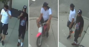 Police are searching for two persons of interest in a shooting that injured two Camden officers.